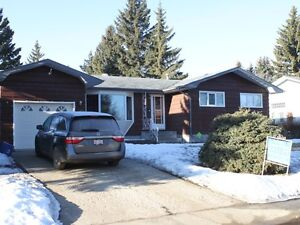 Beautiful yard - mature trees - across from park in Tofield