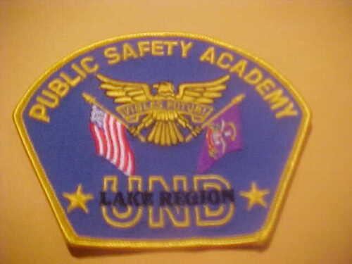 UNIV. OF NORTH  DAKOTA LAKE REGION PUBLIC SAFETY ACADEMY POLICE PATCH SHOULDER