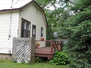NEW PRICE! Cottage like home on mature partially fenced lot.
