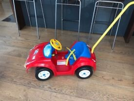 Great push along sit in Power Wheels car by Mattel for toddler
