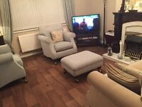 Two seater sofa ,two chairs and large footstool