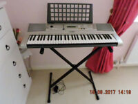 YAMAHA PSR-E313 KEYBOARD c/w STAND, COVER, POWER SUPPLY MUSIC STAND & MANUAL as shown in pictures