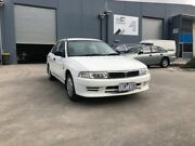 2000 Mitsubishi Lancer CE GLi White 4 Speed Automatic Sedan Newport Hobsons Bay Area Preview