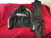 Dainese Ducati black 2-piece touring leathers in very good condition, size Euro 52