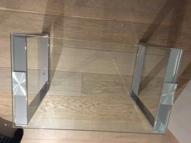 Stylish tempered glass table with chrome legs