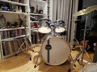 as new, 5 drum. Two cymbal, high hat and drum throne stool. Plus cases for all drums.