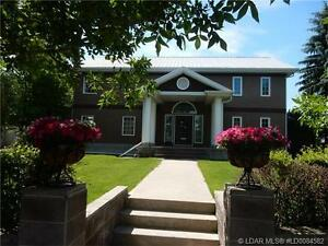 REDUCED!!- One of a kind Coaldale Home and Lot