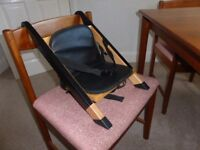 'Handy Sitt' dining chair high chair attachment.