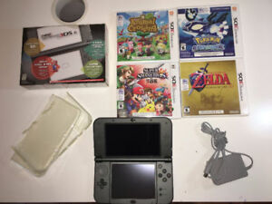 NEW Nintendo 3DS XL with charger, 4 games, case, and box