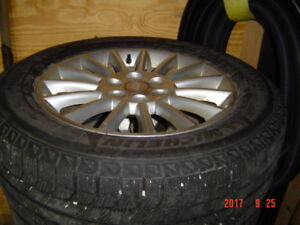 4 snow tires and rims for buick enclave