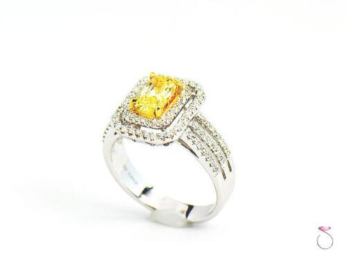 Natural Fancy Intense Yellow Diamond Ring, 1.02 ct. 18K White Gold 1.40 CTW. GIA 1