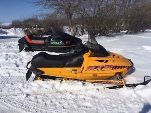 Two snowmobiles for sale, 1996 MXZ 583 and 1984 Cougar 500