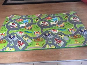 Car play rug with small cars. AVAILABLE