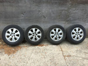 Four Aluminum Toyota wheels and tires.