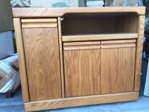 Natural oak stereo cabinet.