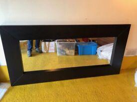 Large dark framed mirror