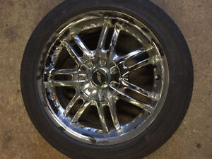 American Racing chrome rims with michelin tires