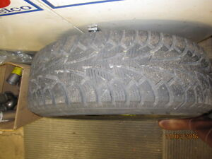 4 Hankook tires on steel rims c/w storage rack London Ontario image 3