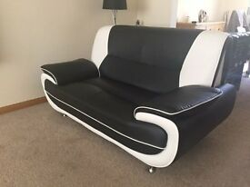 Black and white faux leather 2 seater sofa