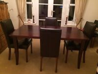 Dark wood dining table + 4 leather chairs