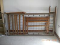 Bunk bed frame with springs and ladder.