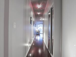 Custom Floor Track Lighting Welcomes You Into This Suite
