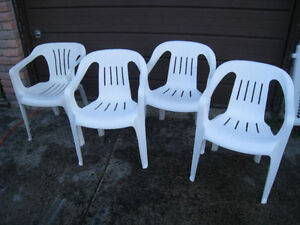 4 white different (3+1) Plastic patio Chairs, good condition
