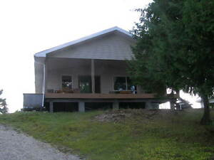 Year round 3 bedroom winterized Cottage with Road Access