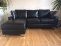 Black leather corner sofa - can deliver