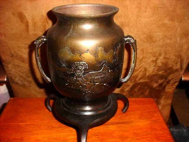 JAPANESE DARK PATINA FOOTED URN VASE  WITH A MOUNTAIN SCENE