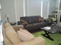 Leather couch and taupe sofa $700.00