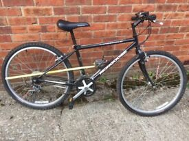 Bicycle, black unisex 22 inch wheels with cross country tires. 15 gears. Mongoose.