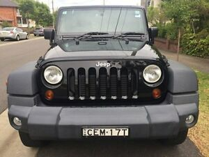 2012 Jeep Wrangler JK MY2012 Unlimited Sport Black 6 Speed Manual Softtop Croydon Burwood Area Preview