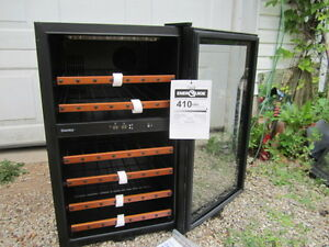 Brand New Danby Dual Zone 38 bottle wine cooler.