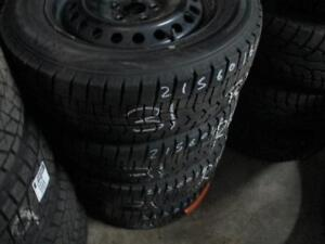 215/60 R16 FORD FUSION WINTER TIRES AND RIMS PACKAGE (SET OF 4) - USED BRIDGESTONE  WINTER  APPROX. 75% TREAD