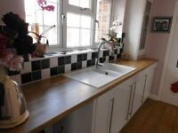 fitted kitchen cupboards/oven/induction hob/laminate worktops nice condition