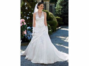 Gorgeous white lace halter top wedding gown with side drape