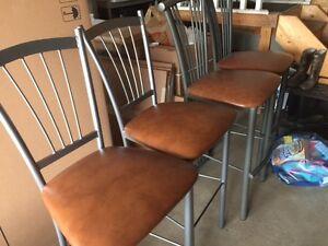 Four steel high back bar stools