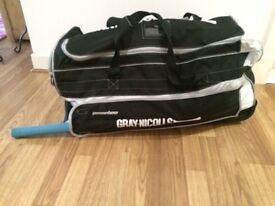Youth's Cricket set comprising bat, pads, gloves helmet and wheelie bag