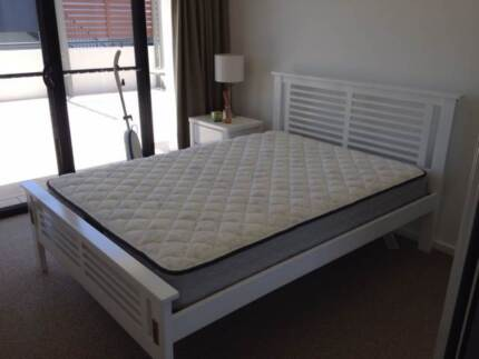 Double bed mattress and bedside table
