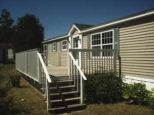 PRE-OWNED MAPLE LEAF MINI HOME - QUISPAMSIS