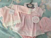 Unworn pink newborn girls outfit