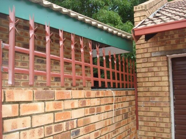 SPIKES PALISADE FENCING. THE ULTIMATE BARRIER FOR YOUR SECURITY. THE INTRUDERS NIGHTMARE.