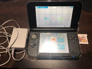 Nintendo 3DS XL with case and Super Smash Bros