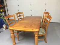 SOLID WOOD TABLE AND 4 CHAIRS $250.00