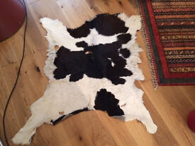 Two cow skin black and white rugs