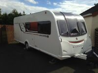 2015 Bailey Unicorn Valencia touring caravan. 4 birth fixed bed. New condition inside and out.