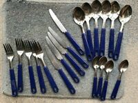 A set of blue handled cutlery