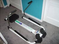 CHALLENGE ROWING MACHINE WITH COMPUTOR ON THE FRONT HARDLY USED