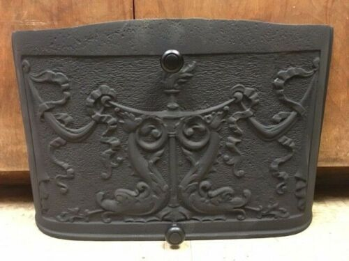 ANTIQUE CAST IRON FIREPLACE COVER WITH GREAT DETAILING DRAGONS RIBBON AND TORCH
